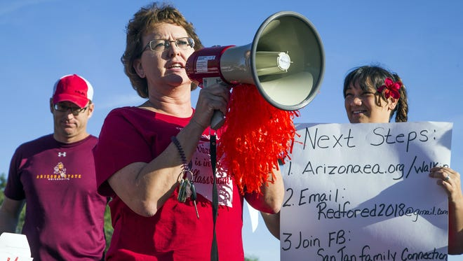 Marthana Hall, a math teacher at San Tan Charter School in Gilbert, Ariz., leads chants April 11, 2016, during a statewide teacher walk-in to support more education financing.
