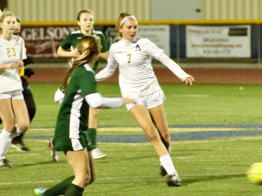 Agoura High junior defender Brit Pollard, shown playing a pass forward during a 1-0 win over visiting La Reina on Dec. 1, leads the Chargers into Marmonte League play.