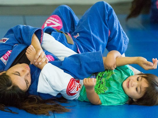 Jacob Benitez, 2, practices his moves with his mother Angela at Gracie Barra Las Cruces.