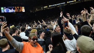 Colorado fans celebrate a defeat of the Arizona Wildcats by storming the court on Feb. 24, 2016 in Boulder.