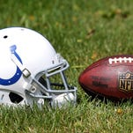 Indianapolis Colts football helmet and ball after practice at the Colts facility on Monday, August 25, 2014.