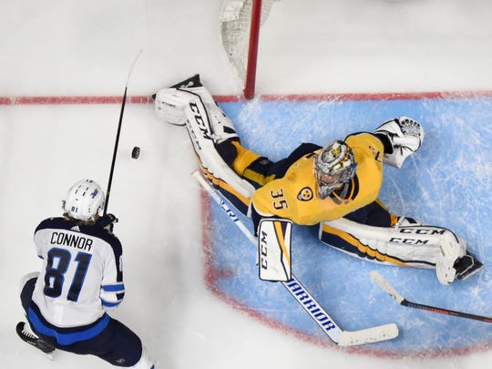 Predators goaltender Pekka Rinne (35) allows a goal by Jets left wing Kyle Connor (81) during the second period of Game 5.