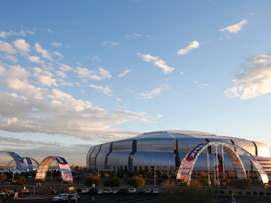 The surrounding area around University of Phoenix Stadium takes shape as the upcoming NFL Super Bowl football game gets closer Tuesday, Jan. 13, 2015, in Glendale, Ariz. (AP Photo/Ross D. Franklin)