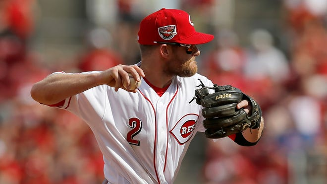 Cincinnati Reds shortstop Zack Cozart (2) makes a play on a ground ball off the bat of Los Angeles Dodgers right fielder Yasiel Puig (66) in the top of the third inning against the Los Angeles Dodgers at Great American Ball Park on Saturday, June 17, 2017.