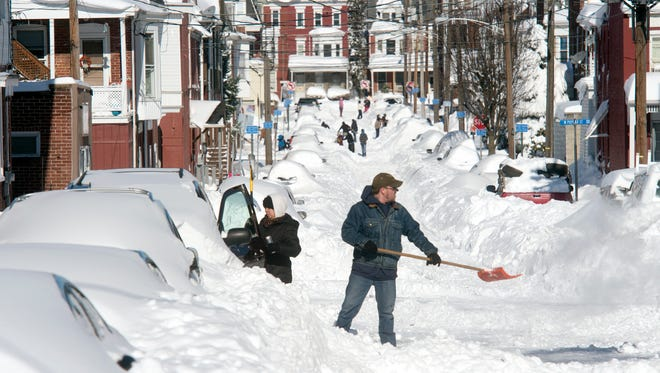 Chris, right, and Milly Beck clean snow from their car in West York Sunday as people around the county got out to clear away Saturday's big storm.