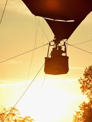 Firefly Music Festival's hot air balloon is seen at sunset during the festival last year.