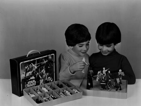 Kids recreate scenes from 'Star Wars' with Kenner's action figures and collector's case.