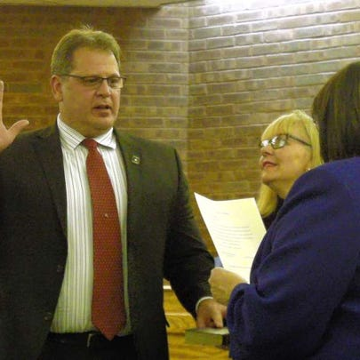 Mayor Michael Dachisen is sworn in on Jan. 5.Councilman Jeremy Jedynak is sworn into office, with Councilwoman Patricia Abrahamsen holding the Bible.