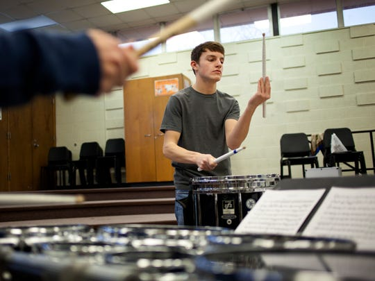 """Daniel Israel, 17, rehearses his composition """"Specks of Blue"""" with a group of students Tuesday at Port Huron Northern High School. A group of students will perform the piece Jan. 24 in Grand Rapids at the Michigan Music Education Association Conference"""