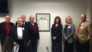 Phi Delta Kappa First Capital Chapter founding members pictured with original charter. From left Nicholas Korbo, Luther Sowers, Richard Hupper, Robert Lease, Kathie Bupp, Diane Eicher and Mike Bubb .