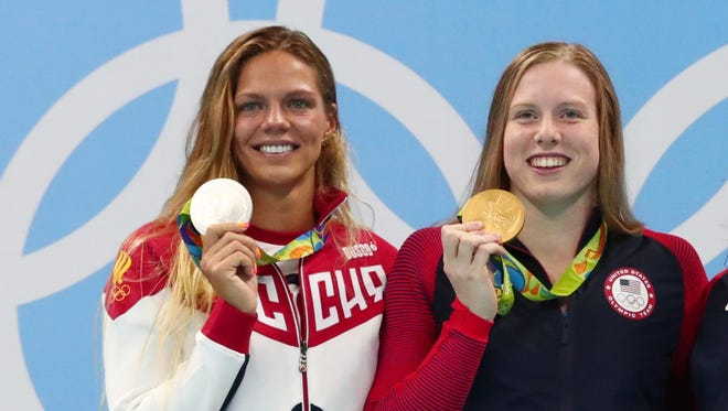 Yulia Efimova (RUS) and Lilly King (USA) on the podium with their medals after the women's 100 breaststroke final during the Rio 2016 Summer Olympic Games.