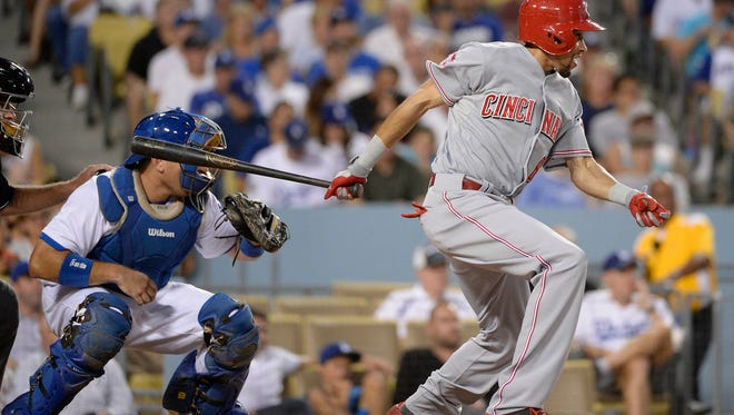 Cincinnati Reds center fielder Billy Hamilton (6) hits an RBI single in the third inning against the Los Angeles Dodgers at Dodger Stadium.