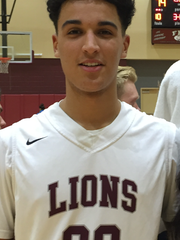 First Baptist Academy basketball player Joel Cotti poses for a photo.