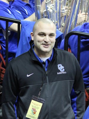 Nick Roeglin is the new boys basketball coach at Oak Creek High School.