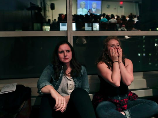 NYU students react while watching the presidential debate between Democratic candidate Hillary Clinton and Republican candidate Donald Trump during a debate watch gathering, Wednesday, Oct. 19, 2016, in New York. (AP Photo/Julie Jacobson)