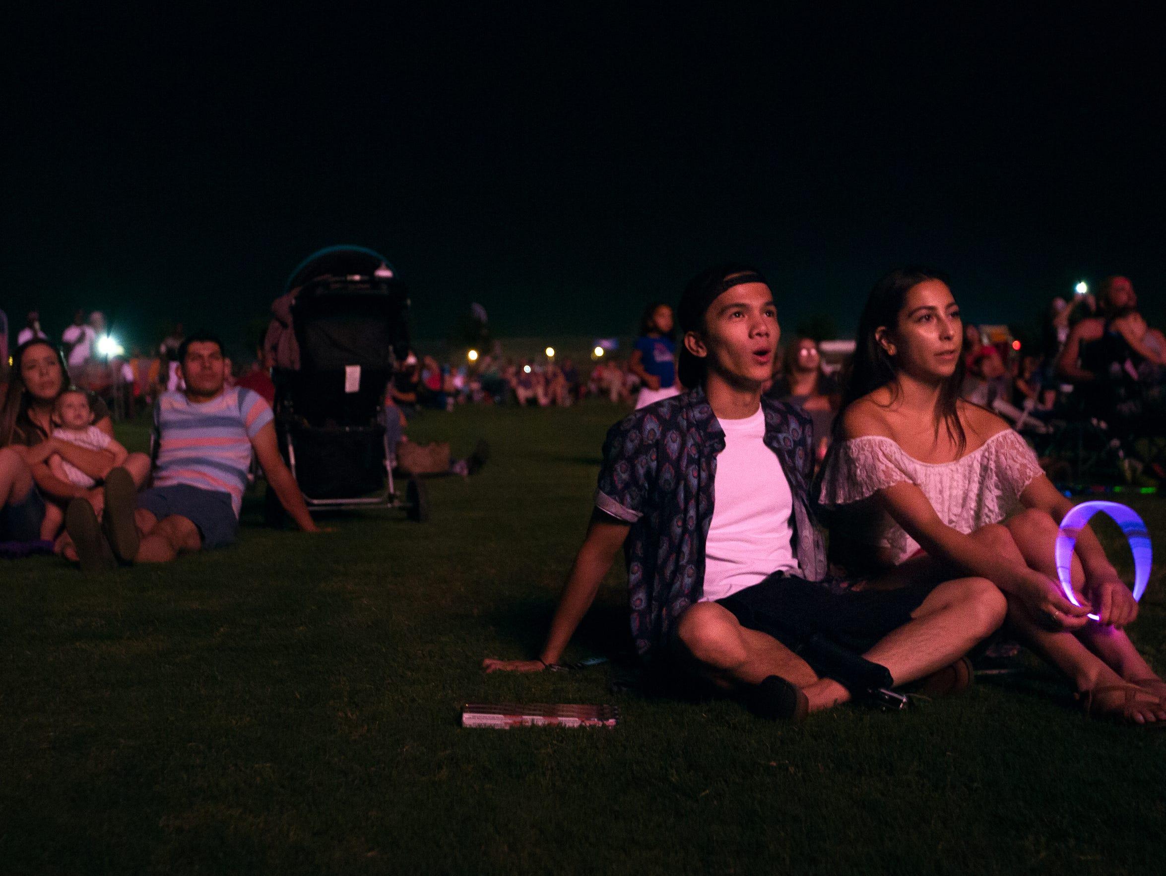 Ian Navarro, right, and Sabrina Flores watch fireworks