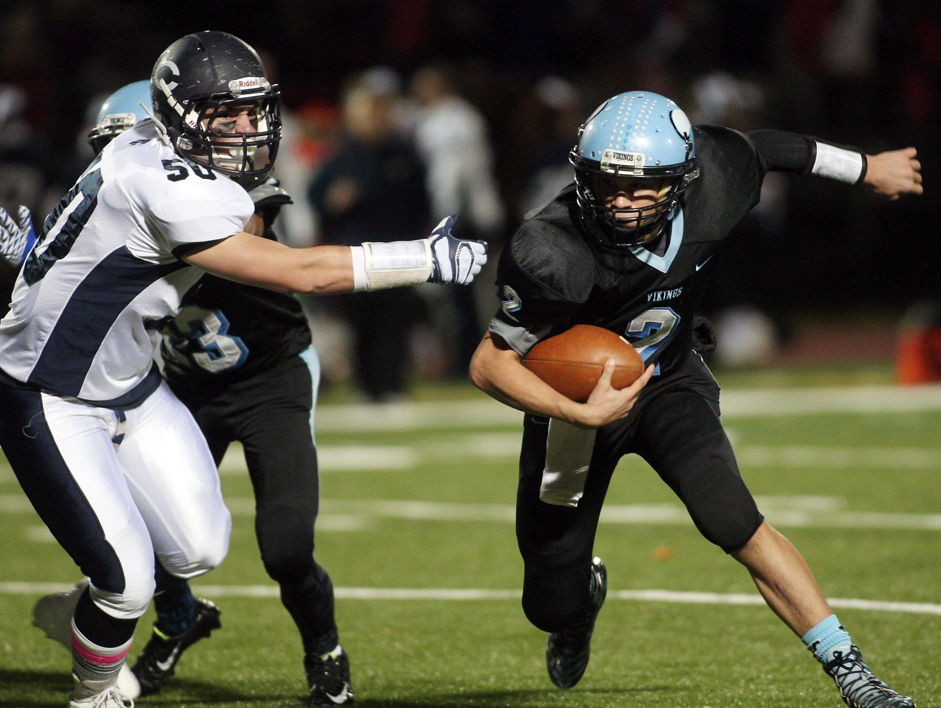 Parsippany Hills quarterback Nick Verducci runs to the end zone on a keeper vs. Chatham in a showdown with playoff implications. October 30, 2015, Parsippany, NJ.