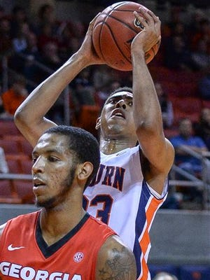Auburn guard TJ Lang (23) shoots against Georgia during the first half of an NCAA college basketball game Wednesday, Feb. 24, 2016, in Auburn, Ala.