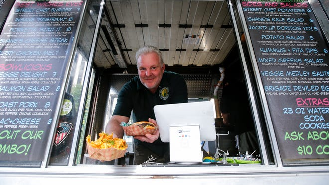Shane Coffey, owner of Street Chef Brigade food truck, is pictured, Monday, June 5, 2017, at Fountain Square in Cincinnati.