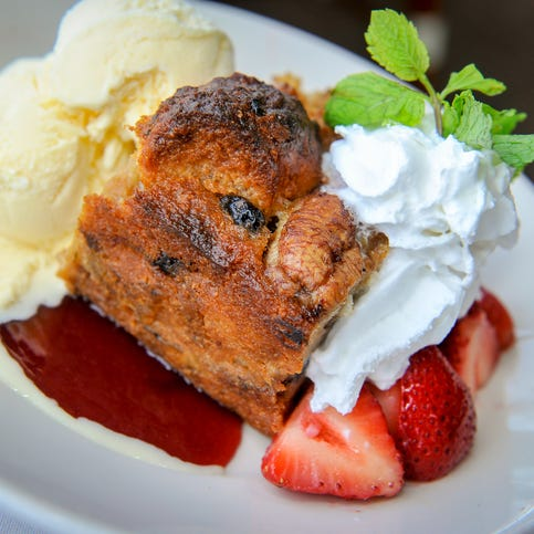 Bread Pudding with vanilla ice cream, strawberries, whipped cream and raspberry sauce at Rooney's Oceanfront Restaurant in Long Branch.