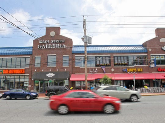 A parking garage is proposed behind the Main Street Galleria in Newark.