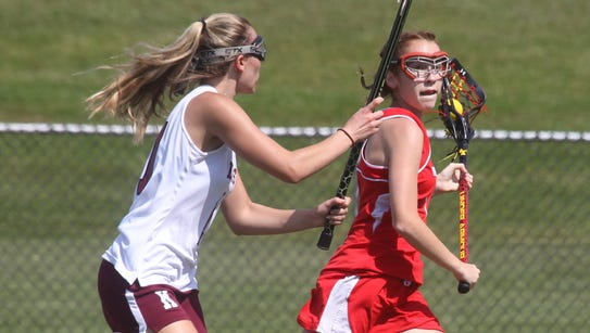 North Rockland's Phoebe Mullarkey is pressured by Kingston's