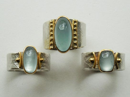 Aquamarine, sterling silver and 22k gold rings by Regina