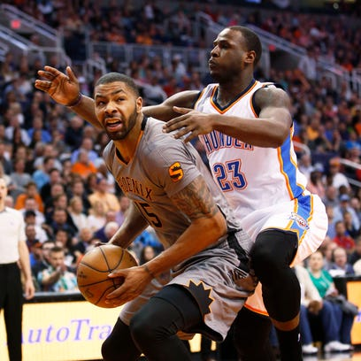 Phoenix Suns Marcus Morris is guarded by Oklahoma City