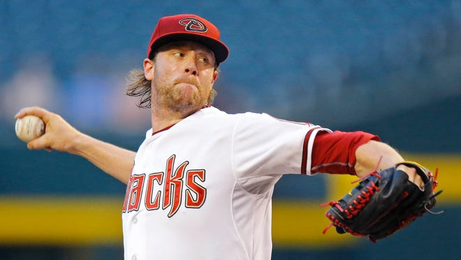Arizona Diamondbacks starting pitcher Archie Bradley throws in the first inning of a game against  the Colorado Rockies on Tuesday, April 28, 2015 in Phoenix, Ariz.