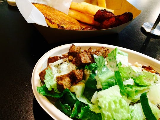 A few dishes at Arepana Latin Grill: A steak bowl and arepas de Choclo or grilled sweet corn cakes, yucca fries and plantains.