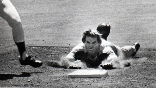 April 1984: Pete Rose does his classic slide to second base after walking. He was safe.