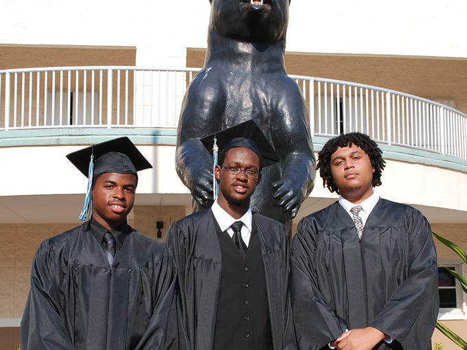 From left, Michael Black, Armond Clarke and Aaron Fonseca pose for a photo before Bayside High School's 2014 graduation Friday night at the Bayside High Stadium.