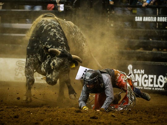 Kenan Isbell falls off a bull during the fifth performance of the 2017 San Angelo Stock Show & Rodeo in February at Foster Communications Coliseum.