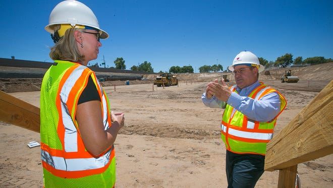 Phoenix Water Services Department spokeswoman Victoria Welch (left) and water facility supervisor Stuart Dalbey visit the construction site.