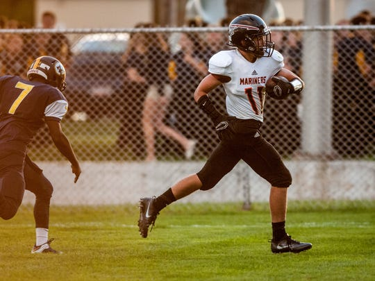 Marine City's Dawson Haney scores during a football