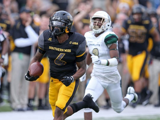 Southern Miss Golden Eagles defensive back Kelsey Douglas (6) returns an interception for a touchdown in the second quarter against the Charlotte 49ers at M. M. Roberts Stadium.