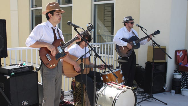In this 2009 file photo, The Smart Brothers perform at the Wine and Food Festival.