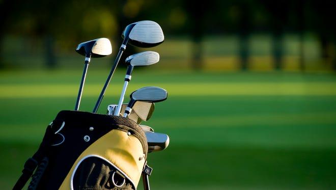 A set of golf clubs on a golf course.