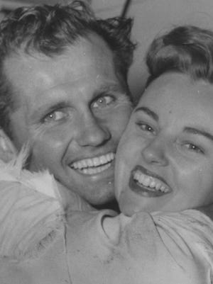 1955 Indianapolis 500 winner Bob Sweikert embraces his wife Dolores after the race.