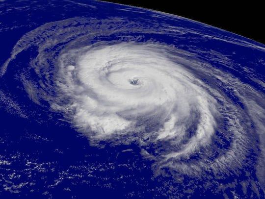 A satellite image shows Hurricane Helene churning over