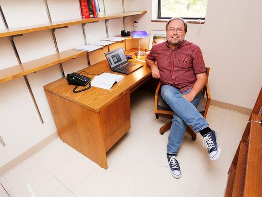 Political science professor Peter Watkins in his office