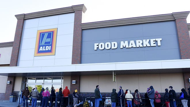 Customers line up outside the new Aldi store before the grand opening May 12.