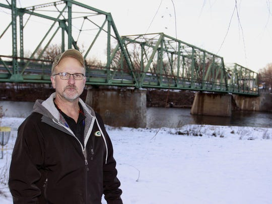 Waverly city council member Dan Lampe stands near the 98-year-old Third Street Bridge in Waverly. The bridge, known as the green bridge, was closed after Mason City inspectors found failed bearings and stringer corrosion.