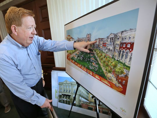 Carmel Mayor Jim Brainard shows an artist's rendering of Carmel City Center development, at City Hall, in June 2014.