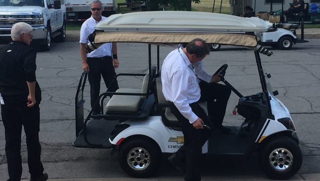 General Motors exec Mark Reuss leaves the Detroit Grand Prix medical center after wrecking the pace car before the start of Sunday's IndyCar race.