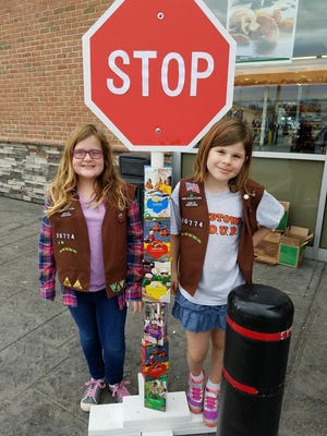 Charlotte Evans and Carley Carrozza, both 9, are a part of Brownie Troop 20774 that is made up of 2nd and 3rd graders.