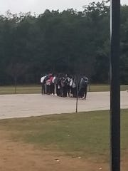 Jackson Liberty High School students protest a photo of their classmates that featured a racial slur.