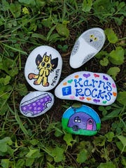 Rocks painted and ready to be hidden by group administrator Kristen Patschke Clark.