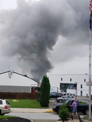 A plume of smoke rises from a fire in Wrightsville
