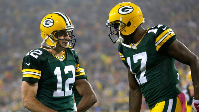 Green Bay Packers' Aaron Rodgers and Davante Adams celebrate after connecting on a second quarter touchdown reception.